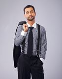 Relaxed Businessman Holding His Coat Royalty Free Stock Image