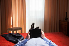Relaxed businessman holding a pad Royalty Free Stock Image