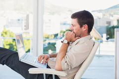 Relaxed businessman with a laptop Royalty Free Stock Photo