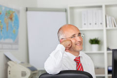 Relaxed businessman leaning on chair Stock Photography