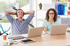 Relaxed businessman listening to music Stock Photos