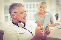 Relaxed businessman looking at his tablet Royalty Free Stock Photo