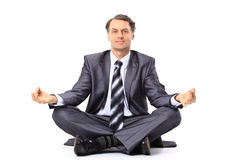 Relaxed businessman meditating Stock Photos