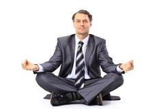 Relaxed businessman meditating Stock Photos