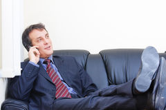 Relaxed businessman on phone Stock Photo