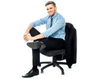 Relaxed businessman posing casually Stock Image