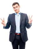 Relaxed businessman posing on white background in business suit. On a white Royalty Free Stock Photos