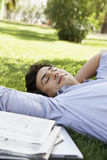 Relaxed Businessman Resting On Grass At Park Stock Photos