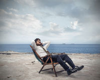 Relaxed businessman at the seaside Royalty Free Stock Photography