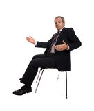 Businessman on a chair Stock Photo