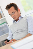 Relaxed businessman sending sms Stock Image