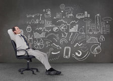 Relaxed businessman sitting on a chair Stock Images