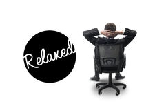 Relaxed businessman sitting on chair Stock Photography