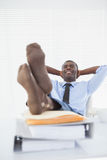 Relaxed businessman sitting in his chair with feet up Royalty Free Stock Photo