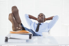 Relaxed businessman sitting in his chair with feet up Stock Image