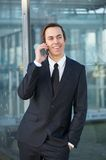Relaxed businessman smiling and talking on mobile phone Royalty Free Stock Photo