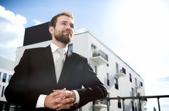 Relaxed businessman standing on balcony of his apartment Stock Photography
