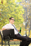 Relaxed businessman taking a break in park Stock Photography