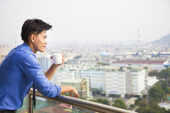 Relaxed businessman watching the city Stock Images
