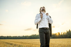 Relaxed businessman in white shirt standing in the middle of whe Stock Photography