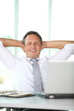 Relaxed businessman at work Stock Image