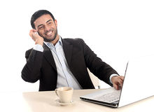 Relaxed businessman working with computer and mobile Stock Photo