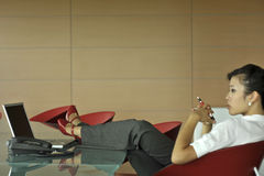 Relaxed businesswoman stock photos