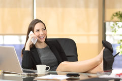 Relaxed businesswoman calling on phone Stock Photos