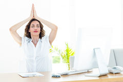 Relaxed businesswoman doing yoga Stock Images