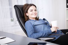 Relaxed businesswoman enjoying her coffee break Royalty Free Stock Photography
