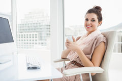 Relaxed businesswoman holding hot drink Stock Photography