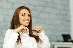 relaxed businesswoman in office environment Royalty Free Stock Images