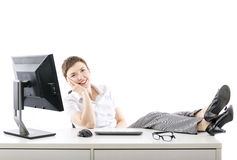 Relaxed businesswoman at office Stock Image