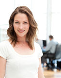 Relaxed businesswoman posing in front of her team Royalty Free Stock Photography