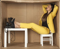 Relaxed businesswoman resting in office Royalty Free Stock Photos