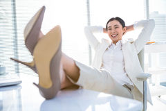 Relaxed businesswoman sitting with her feet up Royalty Free Stock Photography