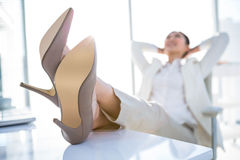Relaxed businesswoman sitting with her feet up Royalty Free Stock Images
