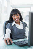 Relaxed businesswoman working on computer Stock Photo