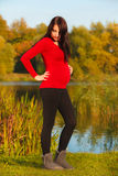 Relaxed calm pregnant woman in park outdoor Stock Photo
