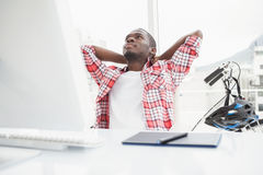 Relaxed casual businessman leaning back Royalty Free Stock Image