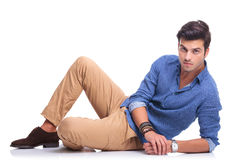 Relaxed casual fashion man lying down Stock Photography