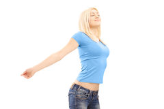 Relaxed casual female spreading her arms Stock Photography