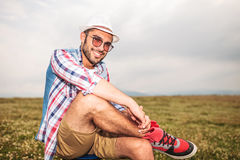 Relaxed casual man sitting on a chair in a field Stock Images