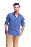 Relaxed casual man standing with hands in pockets Stock Image