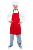 Relaxed chef standing with hands on his waist Stock Image
