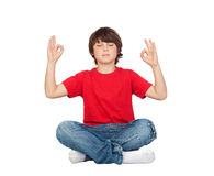 Relaxed child practicing yoga Royalty Free Stock Images