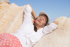 Relaxed confident happy retired woman outdoor Stock Photo