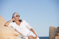 Relaxed confident mature woman at beach Stock Photography