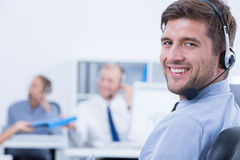 Relaxed and confident telemarketer royalty free stock photos
