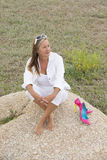 Relaxed confident woman outdoor wth high heels Stock Photo